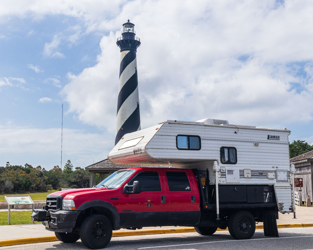 Truck Camper in front of a Lighthouse