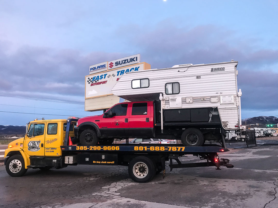 Truck camper on a tow truck